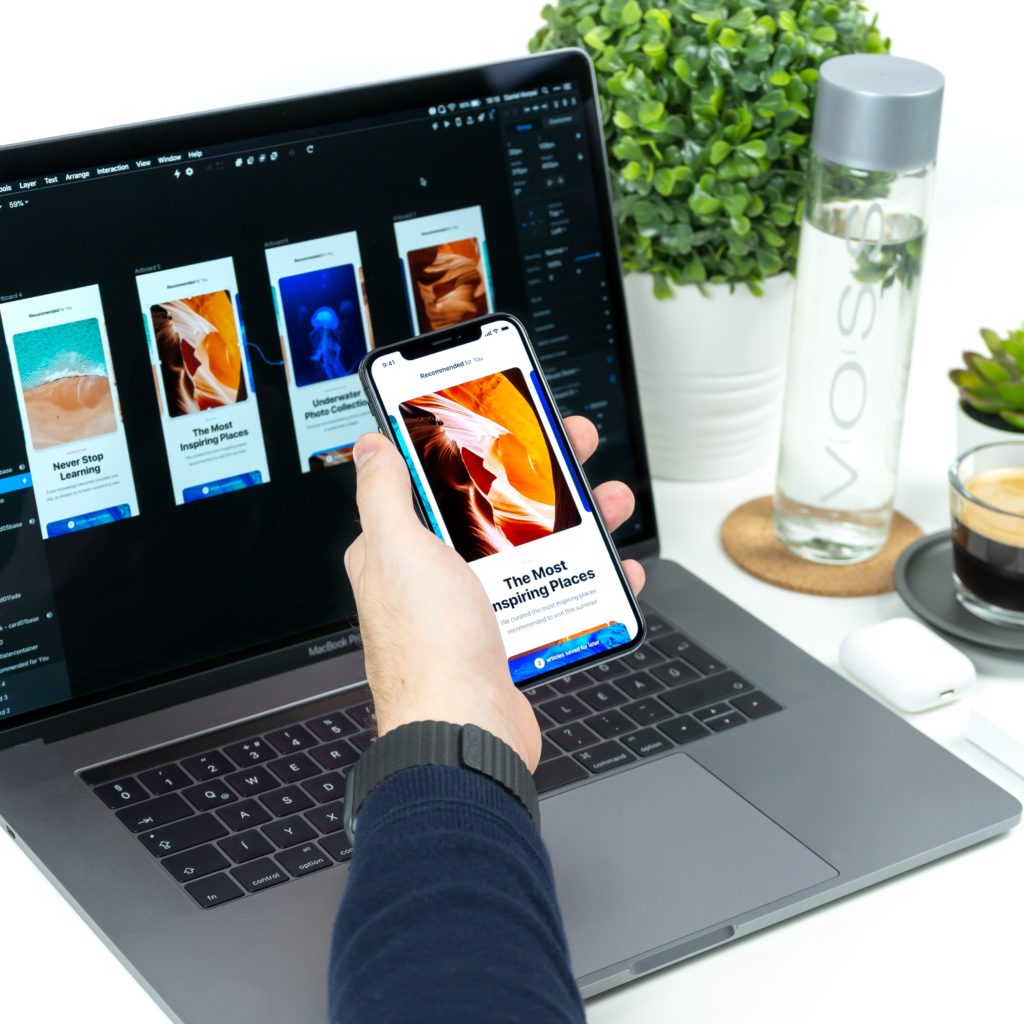Phone and Laptop displaying how remote working is made possible.